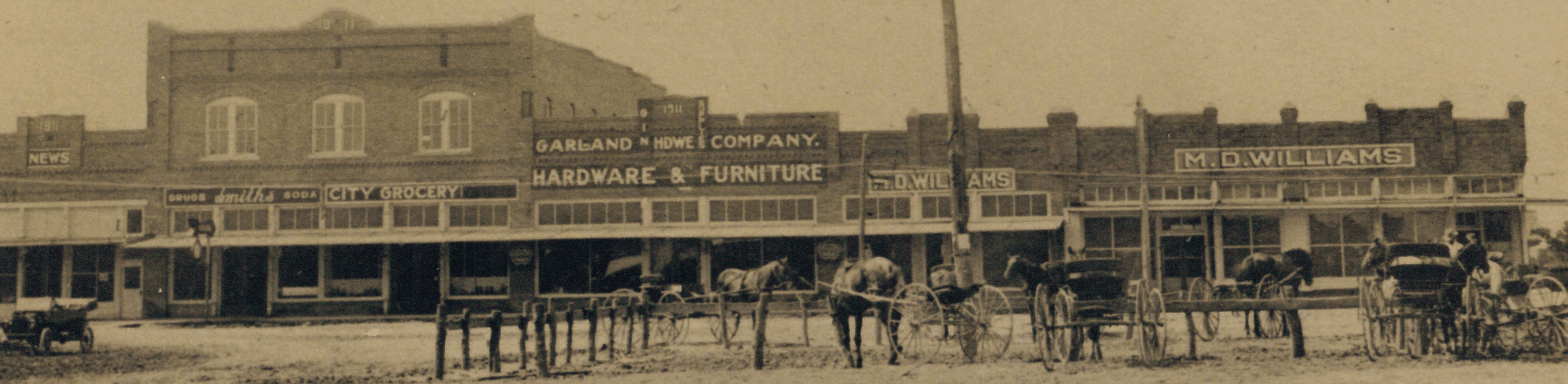 South side of square with men and buggies in foreground.